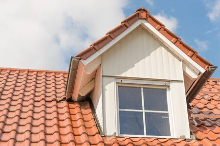 White Dormer window with metal cladding in wood look Archivio Fotografico
