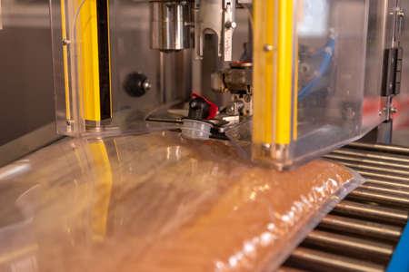 Apple direct juice after pressing. Bottling in bag in box Standard-Bild