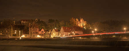 beautiful Landsberg am Lech a city in Bavaria Germany with a waterfall. Shot with long time exposure at night.