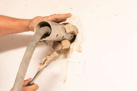A wall breakthrough through a core drilling by professionals with the aid of a machine Standard-Bild