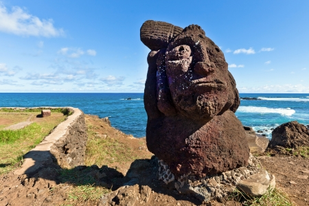 Short standing moai at seashore in Easter Island on sunny day