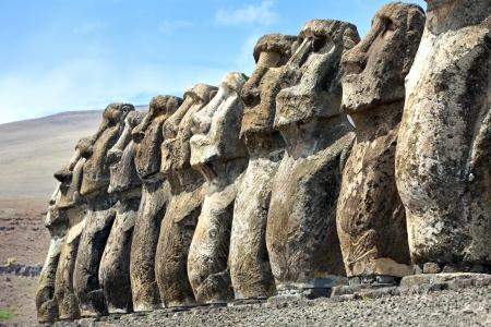 Ten stone moai standing in Easter Island in sunshine