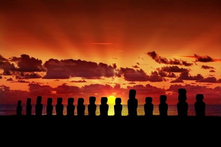 moai: Fifteen silhouettes of standing moai at sunset in Easter Island