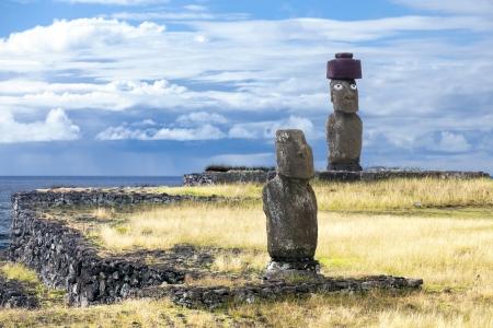 rano raraku: Two Moias in the sea bank in Easter Island