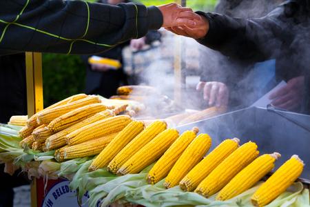 Street vendor selling hot sweet corn cobs photo