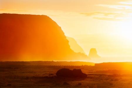 rano raraku: Fallen moai in golden morning haze in Easter Island Stock Photo