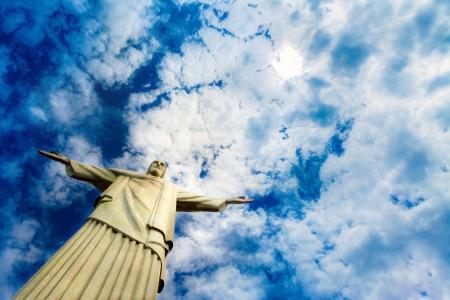rio de janeiro: Christ the redeemer statue in Rio de Janeiro against blue sky