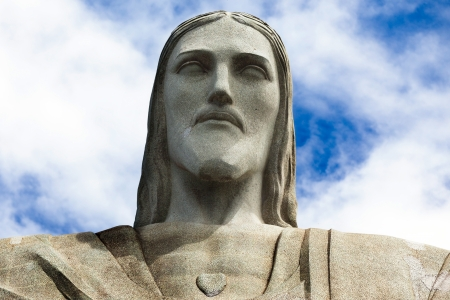 jesus face: Face of the statue of Christ the redeemer in Rio de Janeiro against blue sky
