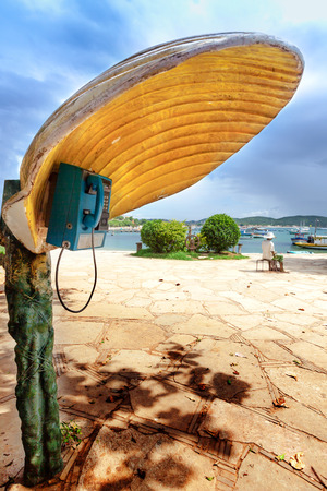 phonebooth: Phonebooth with a shell-shaped cover in Buzios, Brazil