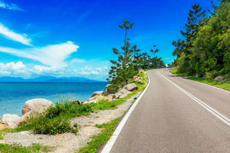 Curving road along sea in Magnetic Island, Australia