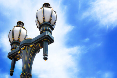 melbourne: Old-fashioned black and gold streetlamps against blue sky Stock Photo
