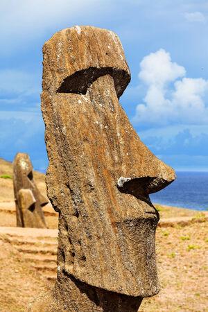 rano raraku: Head of a standing moai in Easter Island against blue sky Stock Photo