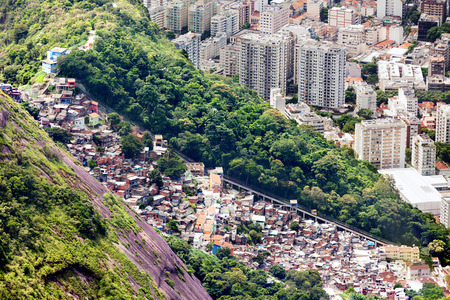 Aerial view of favela and high-rise buildings in Rio de Janeiro, Brazil