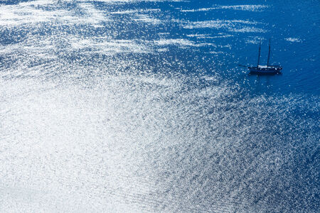 the silvery: Sailing boat in silvery blue sea