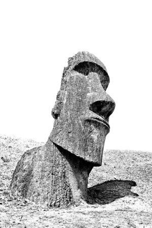 rano raraku: Black and white moai head on a hill in Easter Island Stock Photo