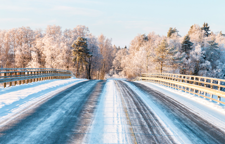 Bridge on a country road on a sunny winter day Stock fotó