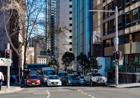 Four lanes of cars waiting at traffic lights in downtown Sydney