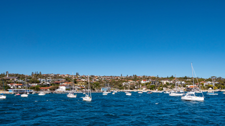 Sailing boats in front of Watsons Bay Australia as seen from the sea