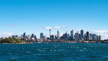 Sydney city skyline seen from the sea on a sunny day