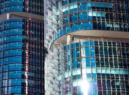 Closeup of blue office building windows in sunshine 版權商用圖片