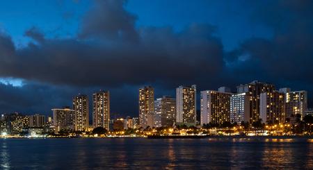 Waikiki Beach at night with dramatic dark clouds in the sky 版權商用圖片