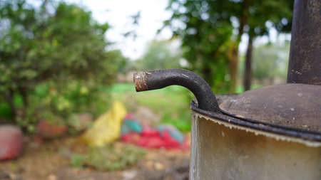 Close up shot of Water heater iron pipe, to pour out boil water from Heater. Warm water concept in winter.