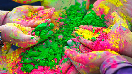 Colorful holi painted hands in different positions. Holi vibrant colors with attractive color dye.