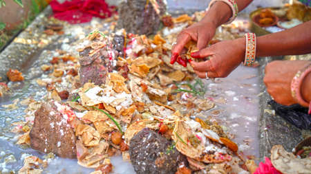 Traditional Hindu festival concept. Hindu females offering prayer and Prasad at temple.