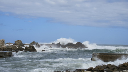 Waves Crashing Against Rock in The Ocean by Break Water for Harbour Stock Photo