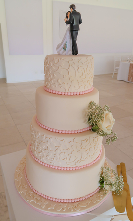 Pink and White Four Tier Wedding Cake