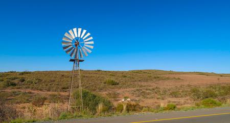 Windmill in the Farmlands Stock Photo