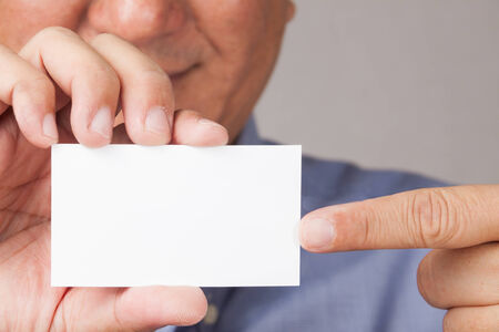 closed up: A closed up shot of a business man pointing to a blank card