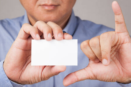 Businessman holding a blank business card photo