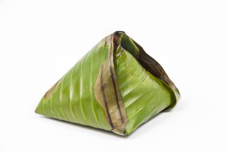 nasi: Single pack of simple and authentic nasi lemak wrapped in banana leaf.
