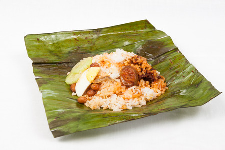 Simple and authentic nasi lemak wrapped in banana leaf. photo
