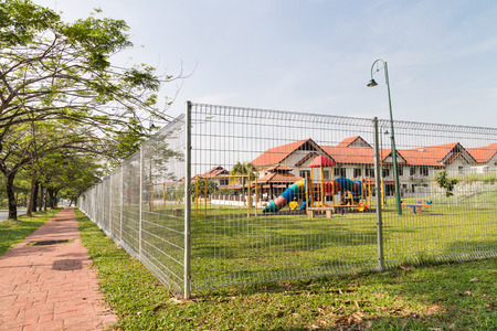 BRC type fence is gaining popularity as a security perimeter at residential and industrial areas. 版權商用圖片 - 35006763