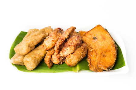 A serving consisting of the combination of fried banana (pisang goreng), fried sweet potatoes (keledek goreng) and fish nuggets (keropok lekor), a popular snack in Malaysia Stock Photo