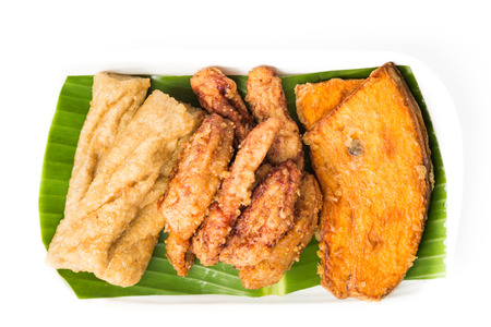 goreng: A serving consisting of the combination of fried banana (pisang goreng), fried sweet potatoes (keledek goreng) and fish nuggets (keropok lekor), a popular snack in Malaysia Stock Photo