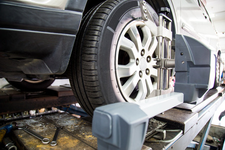 alignment: Automobile wheel alignment with focus on the wheel and equipment