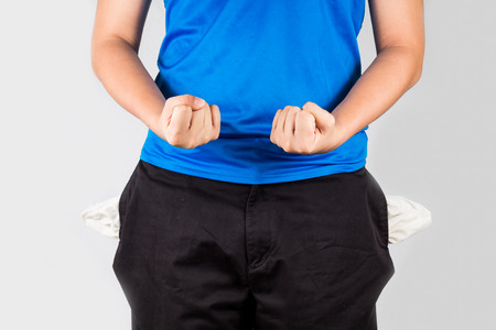 empty pocket: Teenager with empty pocket grip both fist