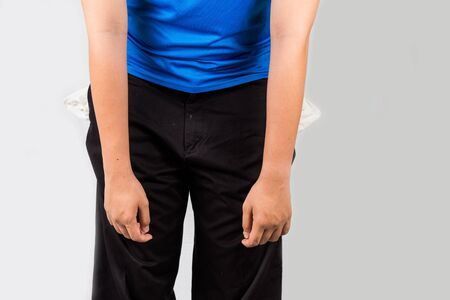 empty pockets: Teenager with empty pocket and slouge posture