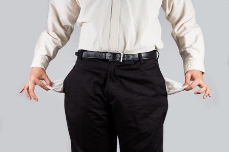 penniless: Men pulling his empty pockets