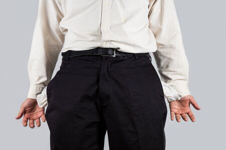 penniless: Man with empty pockets gesturing \ Stock Photo