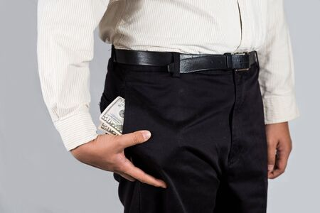abundant: Man with abundant of money in his pockets Stock Photo