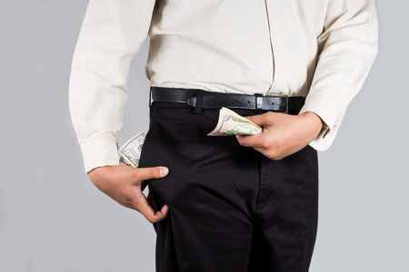abundant: Man with abundant of money in his pockets, holding some note