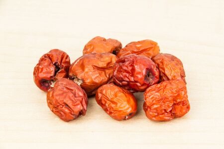 Close up and selective focus on the dried Chinese Red Dates at the foreground photo