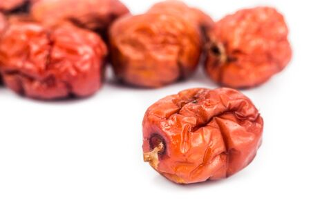 Close up and selective focus on dried Chinese Red Dates at the foreground photo