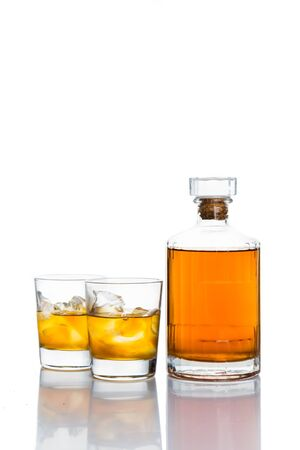 whiskey on the rocks: Whiskey on the rocks, with a whiskey bottle in white background