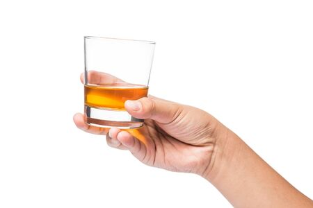 whiskey glass: Hand holding a glass of whiskey