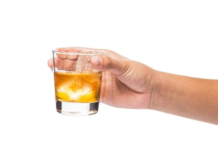 whiskey on the rocks: Hand holding a glass of whiskey on the rocks